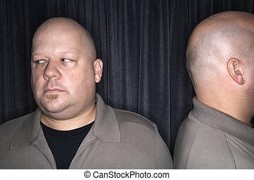 Bald twin men.