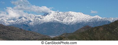 Snow covered mountains as seen from downtown Riverside, California