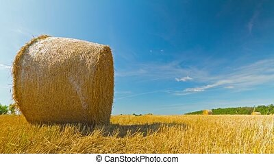 bale of hay in the field, time-lapse with crane