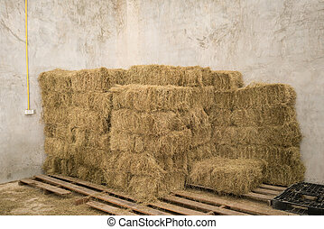 bale of hay stacking