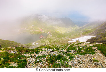 Balea lake in fog view from the top. lovely summer landscape...