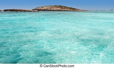 Balearic formentera island Illetes Illetas beach with turquoise sea and beaching wooden rails