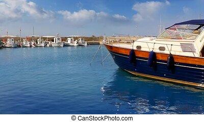Balearic island of Formetera marina port with yachts on blue...