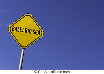 Balearic Sea - yellow sign with blue sky background