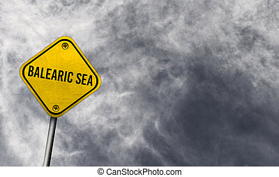 Balearic Sea - yellow sign with cloudy background