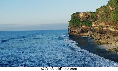 Bali beach Dreamland aerial view. Ocean rocky shore