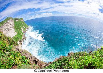 Bali coastline - View of Pura Uluwatu temple in Bali island,...