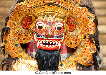 BALI, INDONESIA - MARCH 16: Bali mask during a classic national Balinese dance Barong on March 16, 2013 on Bali, Indonesia. Barong is very popular cultural show on Bali.