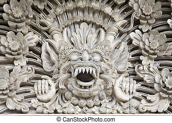Bali sculpture - Traditional stone carving in a temple in...