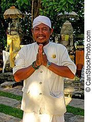 Balinese Greeting - A Balinese man wearing traditional...