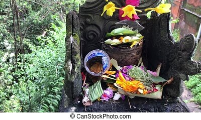 Balinese hindu altar with traditional offerings to gods....