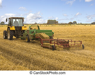 baling machine and tractor - a tractor with baling machine...