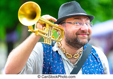 Balkan band street wind musician with his trumpet