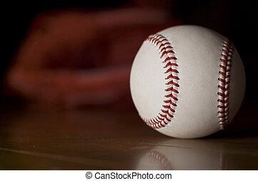 Ball and baseball glove.