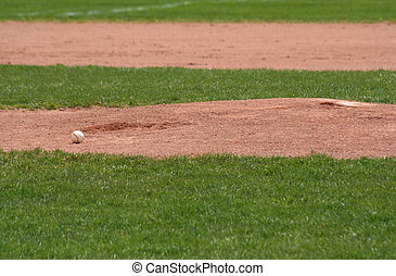 Ball and Mound - A baseball sitting in front of the pitchers...