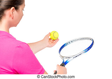 ball and racket in the hands of women, the view from behind on a white background
