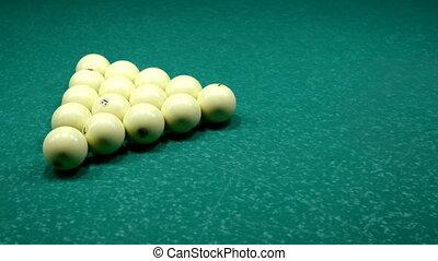 Ball break the triangle pyramid billiard balls on billiard table and getting to start game of russian billiards.
