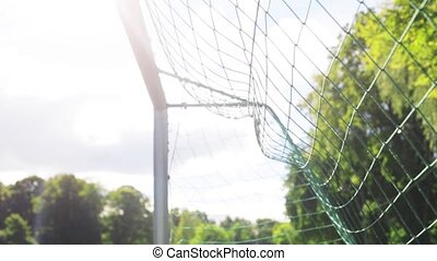 ball flying into football goal net on field