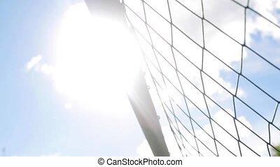 ball flying into football goal net