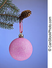 ball for a decoration with the branch of fir-tree