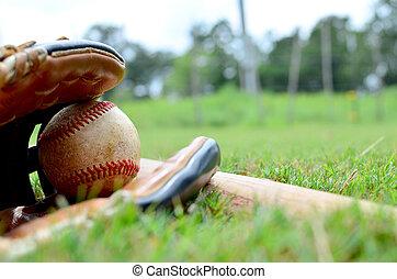 Ball in glove with baseball bat.