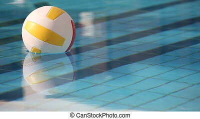 ball in swimming pool - volleyball swimming in pool