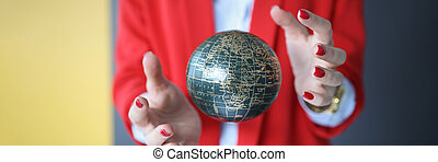 Ball in the air between the female hands.