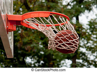 Ball in the basket - shift - Photo of basketball ball in the...
