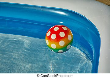 Ball in the water of a pool