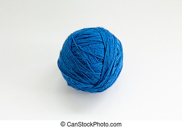 ball of blue thread on a white background