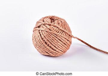 Ball of brown yarn, white background.