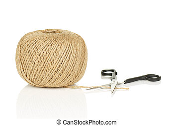 Ball of Natural String With Loose End and Scissors on White...