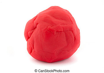 Ball of red play dough over white