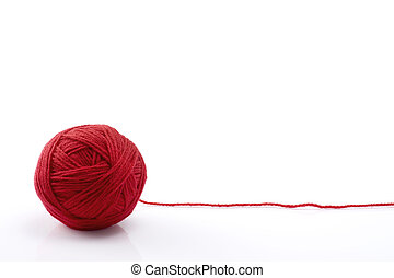 Ball of red yarn on white background