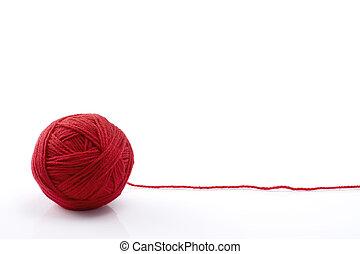 Ball of red yarn