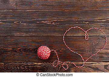 Ball of yarn and heart, copy space.