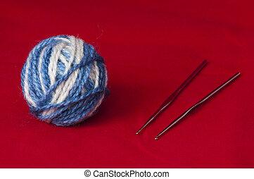Ball of yarn and knitting skewers