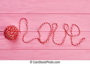 Ball of yarn and word love.