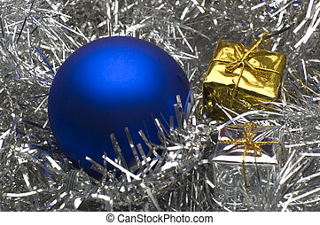 ball - blue christmas ball with small presents close up