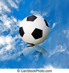 ball soccer ball against the blue sky