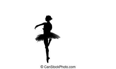 ballerina dancer in tutu showing her techniques, silhouette...