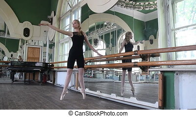 Ballerina dancing with her hands and legs near the machine
