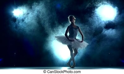 ballerina doing a workout in the classroom on blue, slow motion