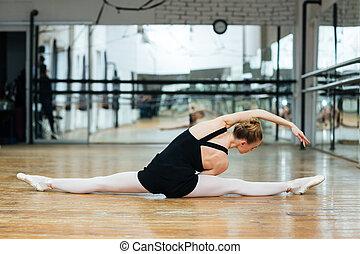 petite ballerina doing exercises in dance class image of