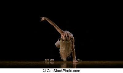 Ballerina girl dancing on the floor