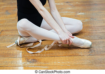 Ballerina having pain in ankle - Cropped image of a...