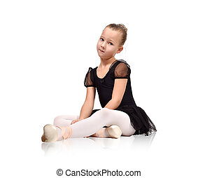 ballerina in black tutu sitting