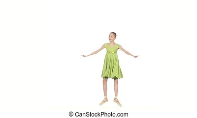 Ballerina in green dress posing on a white. slow motion