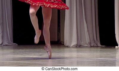 Ballerina in Red Tutu - Ballerina in a red tutu dancing on...