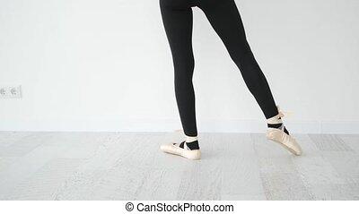 Ballerina legs in beige pointe shoes